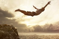cliff-diver-jumping-in