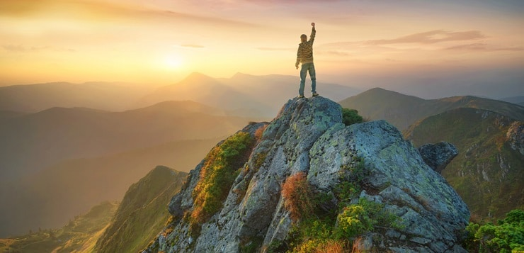Man atop mountain
