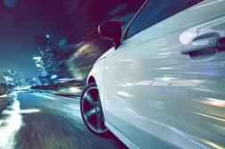 Car driving fast at night