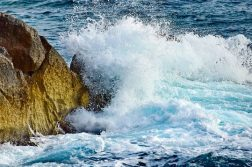 Ocean waves crashing into rock
