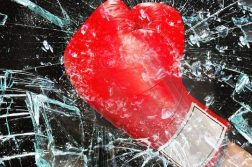 Boxing glove through glass
