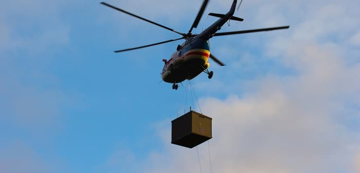 Helicopter carrying cargo